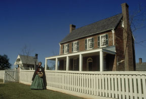 Woman in Civil War costome outside house in Appomattox