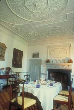 Dining room at Kenmore showing elaborate plaster ceilings and fireplace.